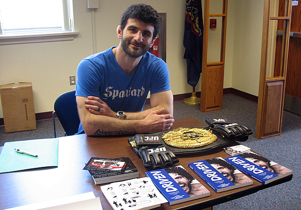 Charlie Brenneman with his books